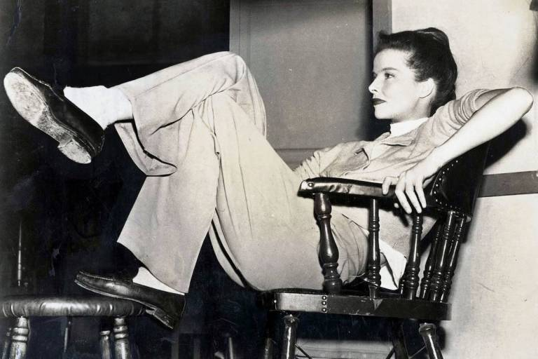 1947 US actress Katherine Hepburn relaxes between scenes of the making of a new Metro-Goldwyn-Mayer film.